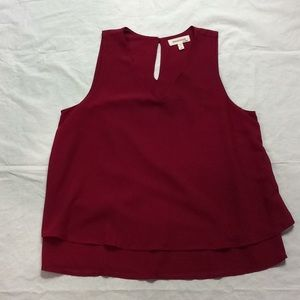 Red professional sleeveless blouse